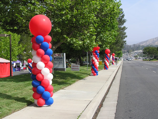Balloon columns for corporate event American Vision Windows