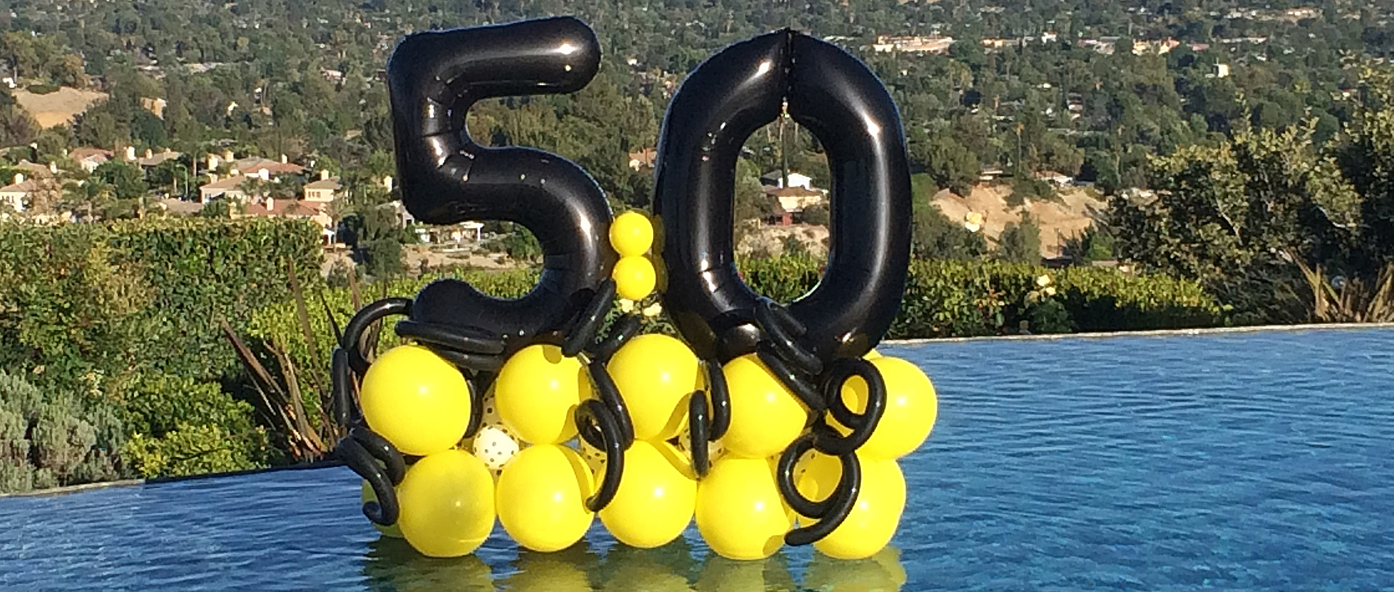 50th birthday balloons in pool