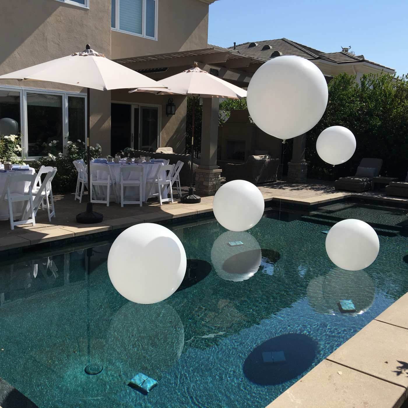 Baby shower 3 foot balloons floating over pool